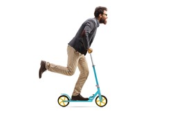 Full length profile shot of a bearded man riding a scooter isolated on white background