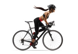 Full length profile shot of a female cyclist with a long ponytail waving, riding a road bicycle isolated on white background