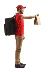 Full length profile shot of a guy with a bag delivering food isolated on white background
