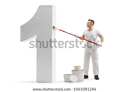 Full length profile shot of a painter painting a number one figure isolated on white background #1061081246