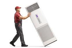 Full length profile shot of a repairman with a portable self standing air conditioning device isolated on white background