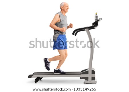 Full length profile shot of a senior running on a treadmill isolated on white background