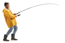 Full length profile shot of a young bearded fisherman catching with a fishing pole isolated on white background