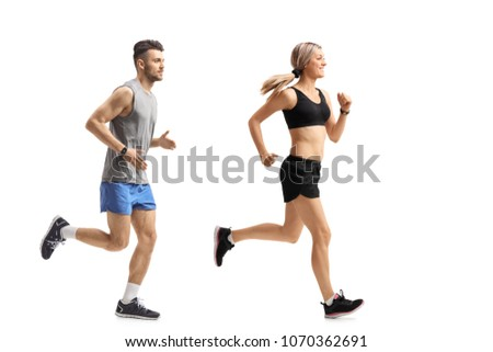 Full length profile shot of a young man and a young woman running isolated on white background