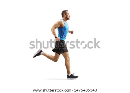 Full length profile shot of a young man jogging isolated on white background