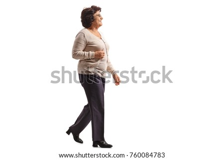 Full length profile shot of an elderly woman walking isolated on white background