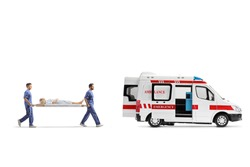 Full length profile shot of healthcare workers carrying a stretcher with a patient into an ambulance vehicle isolated on white background