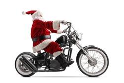 Full length profile shot of Santa Claus riding a custom chopper motorbike isolated on white background