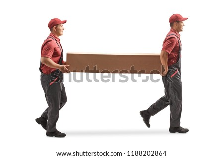 Full length profile shot of two movers carrying a big cardboard box isolated on white background