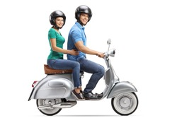Full length profile shot of young male and female riding on a vintage motorbike and wearing helmets isolated on white background