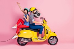 Full length profile side photo crazy cool rock stars two people motorcyclist traveling singers rider drivers ride motor bike man hold boom box woman sing mic isolated pink color background