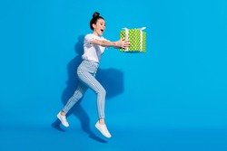 Full length profile side photo crazy girl jump hold green gift box run want give dream package friend 14-ferbuary 8-march holiday wear white t-shirt isolated bright shine color background