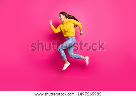 Full length profile side photo of astonished lady jumping running screaming omg wearing knitted sweater dotted denim jeans isolated over fuchsia background