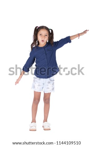 Full-length shot of a lovely little girl wearing a casual outfit, spreading her arms want to fly, isolated on a white background