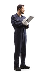 Full length shot of a male worker in a uniform writing a document and looking to the side isolated on white background