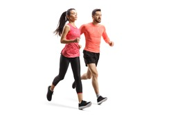 Full length shot of a man and woman in sportswear running together isolated on white background