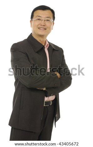 Full length shot of a mature businessman wearing a suit with his arms folded