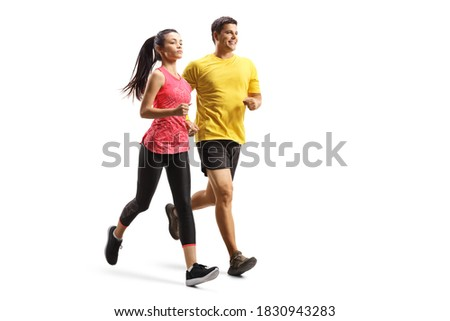 Full length shot of a young man and woman in sportswear jogging isolated on white background Stock foto ©