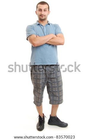 full length shot of a young man in blue shirt, isolated on white