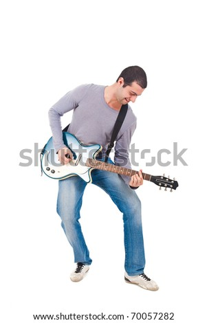 Full length shot of a young man playing guitar isolated on white - stock photo