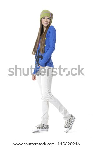 full-length Shot of an attractive fashionable girl walking