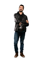 Full-length shot of Biker man keeping the arms crossed in frontal position over isolated white background