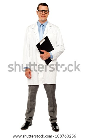 Full length shot of male doctor posing with clipboard over white