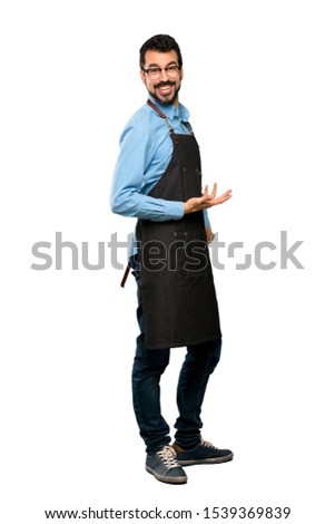 Full-length shot of Man with apron smiling over isolated white background #1539369839
