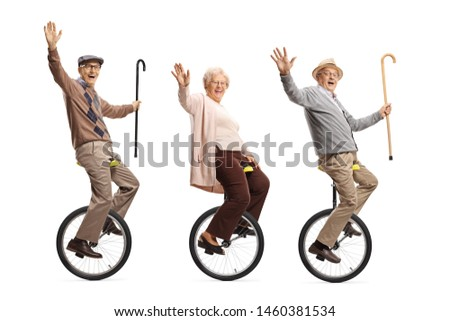Full length shot of senior people riding unicycles and smiling at the camera isolated on white background #1460381534