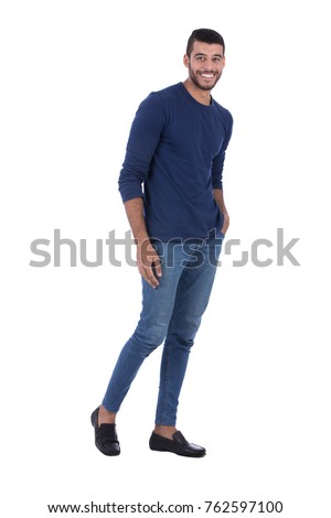 Full-length shot of simple display model with hands in pocket. Isolated on white background.