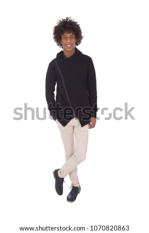 Full-length shot of standing teenager crossed legs putting a hand in the pocket, isolated on a white background. #1070820863