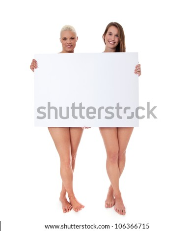 Full length shot of two barely clothed attractive women behind blank white sign. All on white background.