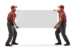 Full length shot of two male workers carrying a blank panel board isolated on white background