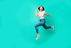 Full length side profile body size photo beautiful amazing her she lady flight jump high little prices rush hurry black friday wear casual jeans denim pastel t-shirt isolated teal turquoise background