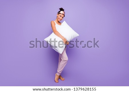 Full length side profile body size photo beautiful she her lady hold arms hands pillow no shoes feet foot satisfied wear sleeping mask pastel pants tank-top pajamas isolated violet purple background