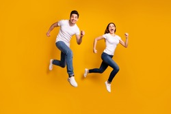 Full length side profile body size photo funky funny she her he him his guy lady jump high hurry shopping black friday low prices wear casual jeans denim white t-shirts isolated yellow background