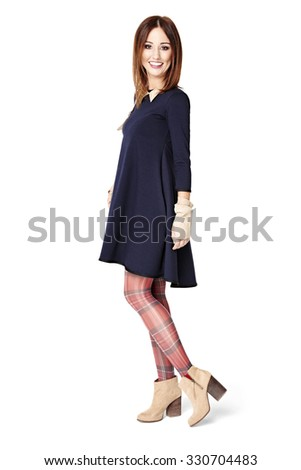 ba371d82c Full length side view of smiling woman looking at camera. Isolated over white  background. Woman in blue dress ...