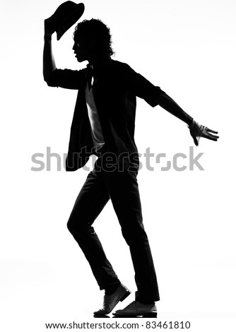 full length silhouette of a young man dancer dancing funky hip hop r&b on  isolated  studio white background - stock photo