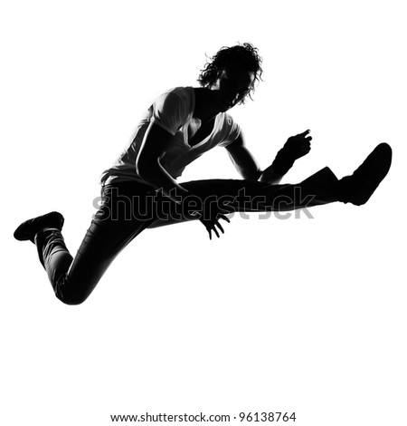 full length silhouette of a young man dancer dancing funky hip hop r&b on  isolated  studio white background