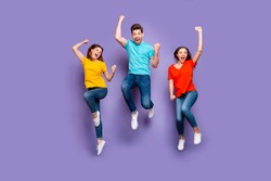 Full length size body photo of three crazy funky carefree buddies teamwork company raising fists up isolated violet background