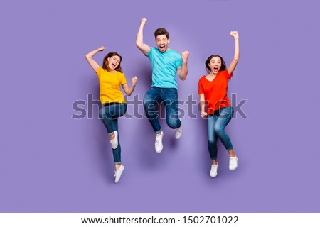 Full length size body photo of three crazy funky carefree buddies teamwork company raising fists up isolated violet background #1502701022