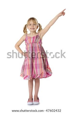 Full length studio photo of little girl pointing upward. White background.