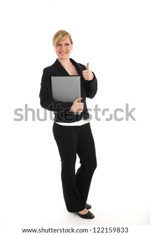 Full length studio portrait of a smiling young professional woman in slacks and a jacket giving a thumbs up sign of approval and success isolated on white
