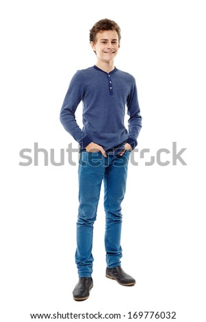 Full length studio portrait of cheerful trendy teenager with hands in pockets, isolated over white background - stock photo