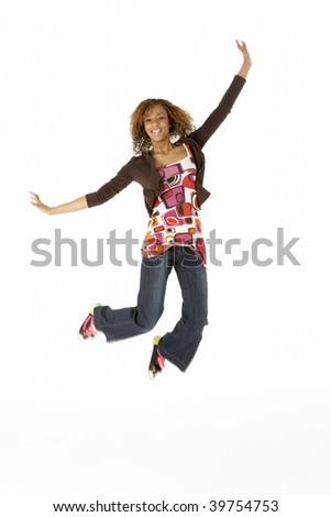 Full Length Studio Portrait Of Jumping Teenage Girl - stock photo