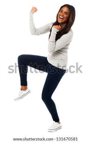 Full length studio shot of beautiful woman having great time.