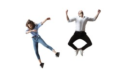 Full length studio shot of young woman and man hovering in air