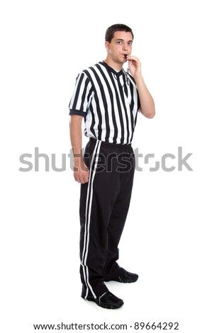 Full length teen referee portrait blowing his whistle isolated on white