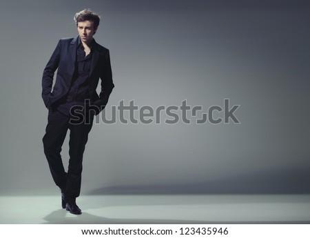 full length trendy elegant young man
