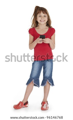 Full length view of little girl standing, holding smart phone, on white background.
